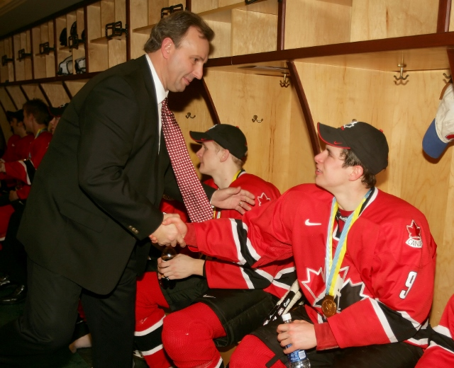 GRAND FORKS, ND - JANUARY 4:  Sidney Crosby #9 of Canada is congratulated by head coach Brent Sutter after Canada won the gold medal game 6-1 over Russia at the World Junior Hockey Championships on January 4, 2005 at the Ralph Englestad Arena in Grand For