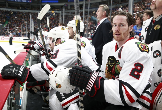 VANCOUVER, BC - NOVEMBER 23: Duncan Keith #2 of the Chicago Blackhawks looks on from the bench during their NHL game against the Vancouver Canucks at Rogers Arena on November 23, 2013 in Vancouver, British Columbia, Canada. Chicago won 2-1. (Photo by Jeff