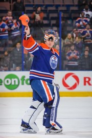 EDMONTON, AB - MARCH 04: Ben Scrivens #30 of the Edmonton Oilers salutes the crowd after earning the second of three stars after the Oilers defeated the Ottawa Senators during an NHL game at Rexall Place on March 04, 2014 in Edmonton, Alberta, Canada. (Ph