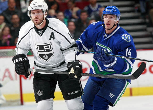 VANCOUVER, BC - NOVEMBER 25:  Mike Richards #10 of the Los Angeles Kings and Alexandre Burrows #14 of the Vancouver Canucks skate up ice during their NHL at Rogers Arena on November 25, 2013 in Vancouver, British Columbia, Canada.  Los Angeles won 3-2. (P