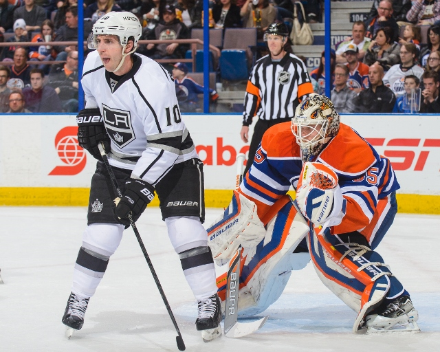 EDMONTON, AB - APRIL 10: Viktor Fasth #35 of the Edmonton Oilers defends net against Mike Richards #10 of the Los Angeles Kings during an NHL game at Rexall Place on April 10, 2014 in Edmonton, Alberta, Canada. (Photo by Derek Leung/Getty Images)