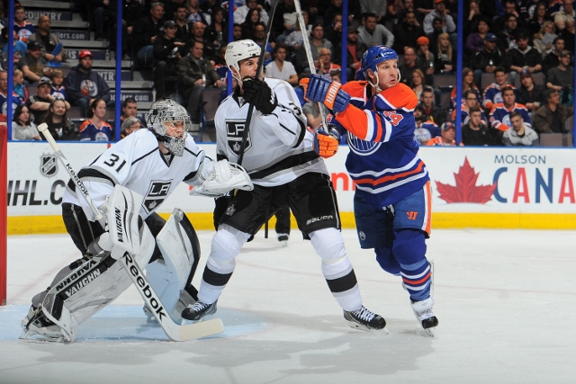 EDMONTON, AB - APRIL 10: Ryan Smyth #94 of the Edmonton Oilers battles for position against Willie Mitchell #33 and Martin Jones #31 of the Los Angeles Kings on April 10, 2014 at Rexall Place in Edmonton, Alberta, Canada. (Photo by Andy Devlin/NHLI via Ge