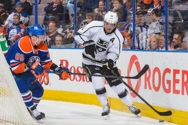 EDMONTON, AB - APRIL 10:  Martin Marincin #85 of the Edmonton Oilers fights for the puck against Anze Kopitar #11 of the Los Angeles Kings during an NHL game at Rexall Place on April 10, 2014 in Edmonton, Alberta, Canada. The Kings defeated the Flames 3-0