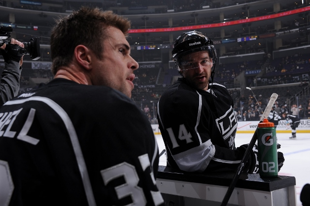 LOS ANGELES, CA - JANUARY 9: Willie Mitchell #33 and Justin Williams #14 of the Los Angeles Kings converse before a game against the Boston Bruins at STAPLES Center on January 9, 2014 in Los Angeles, California. (Photo by Juan Ocampo/NHLI via Getty Images