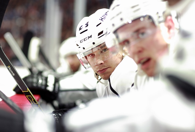 VANCOUVER, BC - APRIL 5:  Dustin Brown #23 of the Los Angeles Kings looks on from the bench during their NHL game against the Vancouver Canucks at Rogers Arena April 5, 2014 in Vancouver, British Columbia, Canada.  Vancouver won 2-1. (Photo by Jeff Vinnic