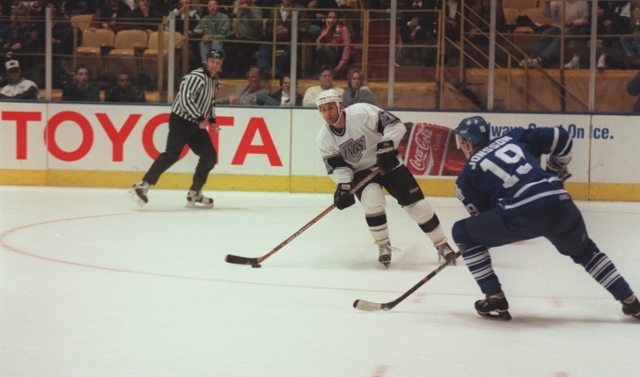 16 Dec 1995: Forward Tony Granato #21 of the Los Angeles Kings focuses on the goal as he stick handles the puck while moving in to the offensive zone despite receiving defensive pressure from Kenny Jonsson #19 of the Toronto Maple Leafs during a line shif