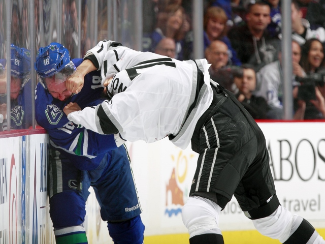 VANCOUVER, BC - NOVEMBER 25:  Ryan Stanton #18 of the Vancouver Canucks and Jordan Nolan #71 of the Los Angeles Kings fight during their NHL game at Rogers Arena on November 25, 2013 in Vancouver, British Columbia, Canada.  (Photo by Jeff Vinnick/NHLI via