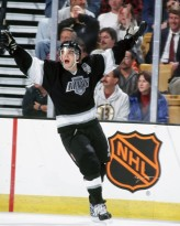 BOSTON, MA. - 1990's: Luc Robitaille #20 of the Los Angeles Kings celebrates goal against the Boston Bruins at the Fleet Center in Boston.  (Photo by Steve Babineau/NHLI via Getty Images)