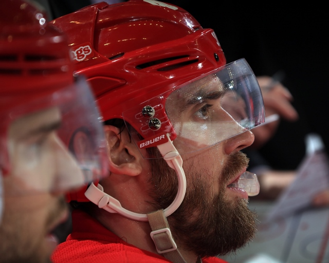 DETROIT, MI - OCTOBER 23: Henrik Zetterberg #40 of the Detroit Red Wings watches the action from the bench against the Pittsburgh Penguins during a NHL game on October 23, 2014 at Joe Louis Arena in Detroit, Michigan. The Wings defeated the Penguins 3-2 i