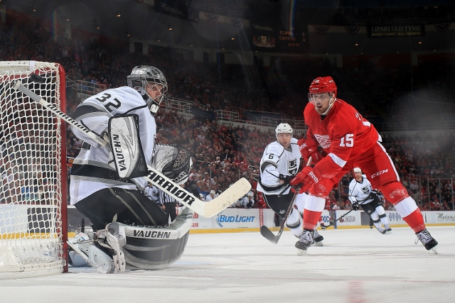DETROIT, MI - JANUARY 18: Jonathan Quick #32 of the Los Angeles Kings makes a save on Riley Sheahan #15 of the Detroit Red Wings during an NHL game on January 18, 2014 at Joe Louis Arena in Detroit, Michigan. The Red Wings defeated the Kings 3-2 in a shoo