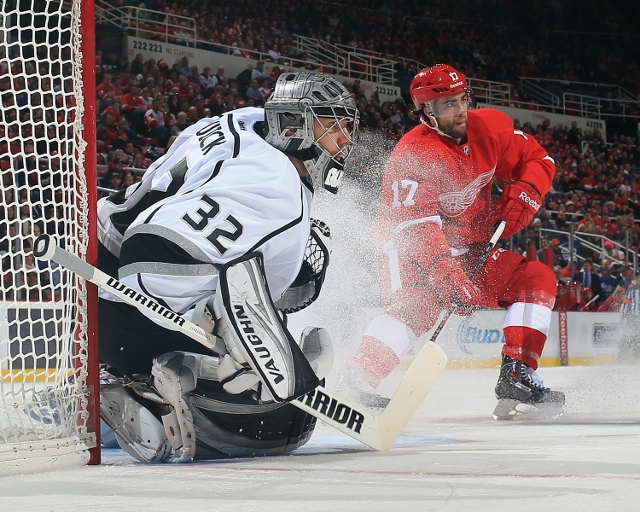 DETROIT, MI - JANUARY 18: Jonathan Quick #32 of the Los Angeles Kings follows the play as Patrick Eaves #17 of the Detroit Red Wings looks to make a play during an NHL game on January 18, 2014 at Joe Louis Arena in Detroit, Michigan. The Red Wings defeate