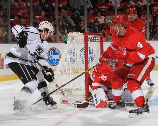DETROIT, MI - JANUARY 18: Jakub Kindl #4 and Jimmy Howard #35 of the Detroit Red Wings defend the corner of the net as Justin Williams #14 of the Los Angeles Kings tries to score during an NHL game on January 18, 2014 at Joe Louis Arena in Detroit, Michig