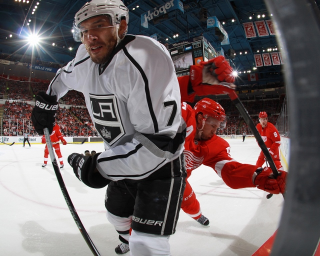 DETROIT, MI - OCTOBER 31: Dwight King #74 of the Los Angeles Kings and Niklas Kronwall #55 of the Detroit Red Wings battle in the corner in the second period during a NHL game on October 31, 2014 at Joe Louis Arena in Detroit, Michigan. (Dave Reginek/NHLI