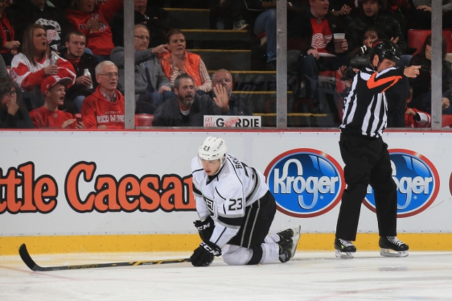 DETROIT, MI - OCTOBER 31: Dustin Brown #23 of the Los Angeles Kings is awarded a penalty shot in the third period by referee Paul Devorski #10 during a NHL game against the Detroit Red Wings on October 31, 2014 at Joe Louis Arena in Detroit, Michigan. The