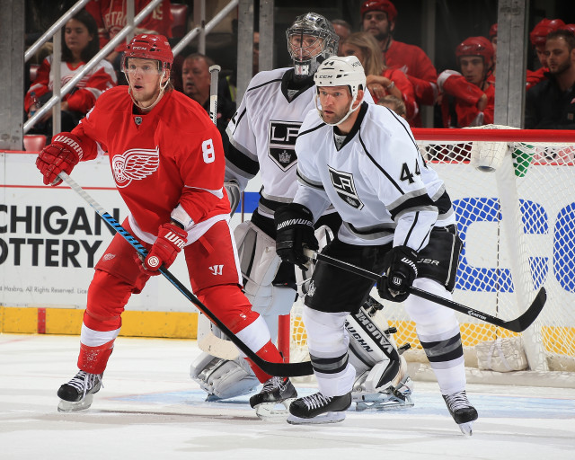 DETROIT, MI - OCTOBER 31: Justin Abdelkader #8 of the Detroit Red Wings sets up in front of Jonathan Quick #32 and Robyn Regehr #44 of the Los Angeles Kings during a NHL game on October 31, 2014 at Joe Louis Arena in Detroit, Michigan. The Wings defeated