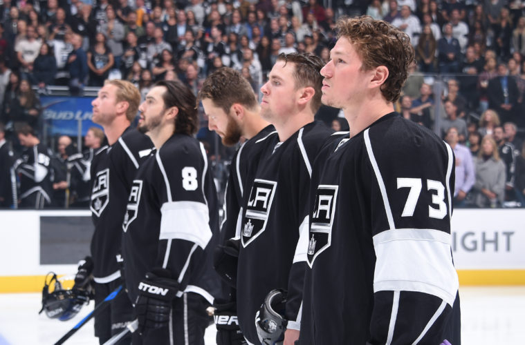 LOS ANGELES, CA - OCTOBER 07: Jeff Carter #77,Drew Doughty #8, Jake Muzzin #6, Tanner Pearson #70, and Tyler Toffoli #73 of the Los Angeles Kings look on before a game against the San Jose Sharks in the NHL season opener at STAPLES Center on October 07, 2015 in Los Angeles, California. (Photo by Juan Ocampo/NHLI via Getty Images)