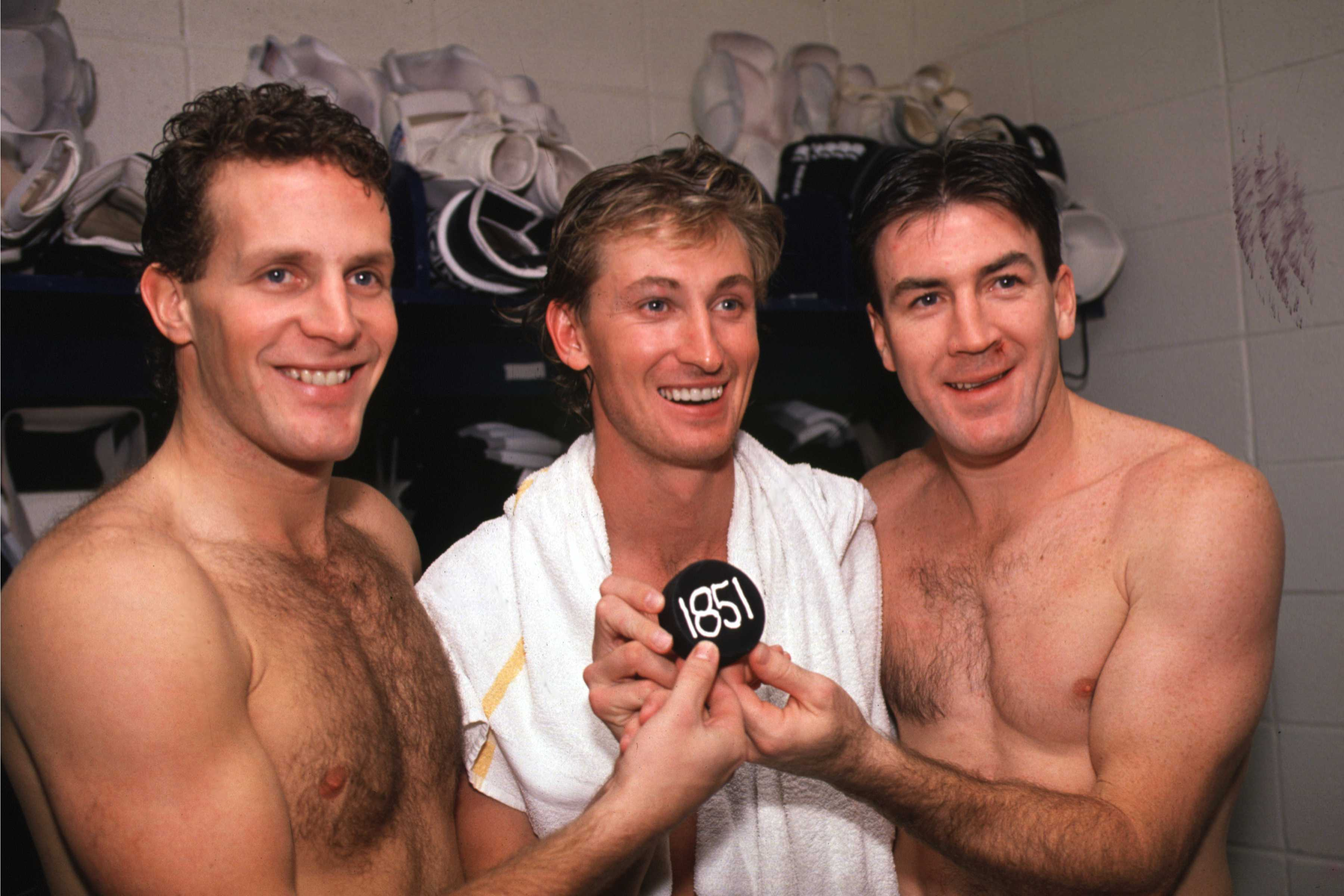 1999 Season: Wayne Gretzky, Steve Duchesne, and Dave Taylor hold up the 1851 NHL point puck.  (Photo by Bruce Bennett Studios/Getty Images)