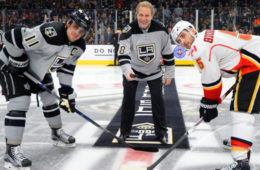 LOS ANGELES, CA - NOVEMBER 5:  Former Los Angeles Kings player Steve Duchesne, center, participates in the ceremonial puck drop with Anze Kopitar #11 of the Los Angeles Kings and Mark Giordano #5 of the Calgary Flames on November 5, 2016 at Staples Center in Los Angeles, California. (Photo by Aaron Poole/NHLI via Getty Images)