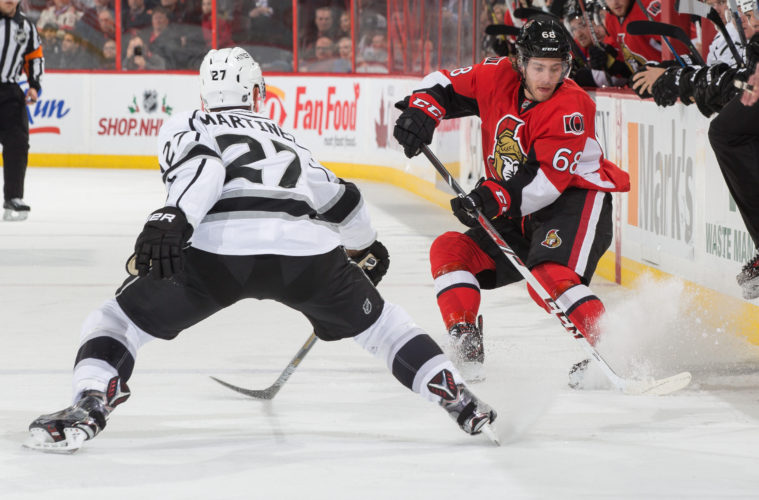 OTTAWA, ON - DECEMBER 14: Mike Hoffman #68 of the Ottawa Senators stickhandles the puck at the blue line against Alec Martinez #27 of the Los Angeles Kings at Canadian Tire Centre on December 14, 2015 in Ottawa, Ontario, Canada.  (Photo by Andre Ringuette/NHLI via Getty Images)