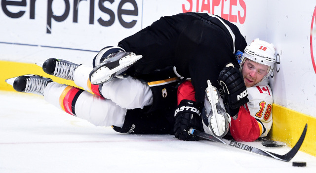 LOS ANGELES, CA - MARCH 31:  Matt Stajan #18 of the Calgary Flames is checked to the ice by Drew Doughty #8 of the Los Angeles Kings during the first period at Staples Center on March 31, 2016 in Los Angeles, California.  (Photo by Harry How/Getty Images)