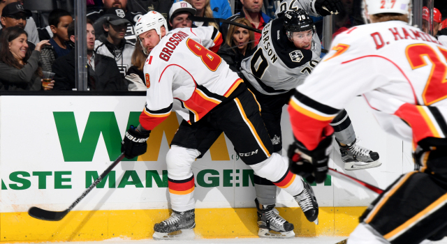 LOS ANGELES, CA - NOVEMBER 5:  Nicklas Grossmann #8 of the Calgary Flames checks Tanner Pearson #70 of the Los Angeles Kings during the game on November 5, 2016 at Staples Center in Los Angeles, California. (Photo by Aaron Poole/NHLI via Getty Images)