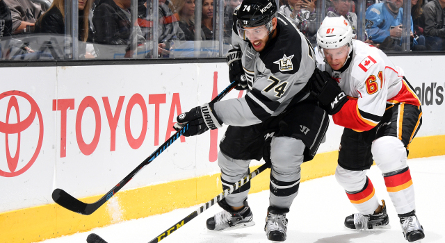 LOS ANGELES, CA - NOVEMBER 5:  Dwight King #74 of the Los Angeles Kings battles for the puck against Brett Kulak #61 of the Calgary Flames on November 5, 2016 at Staples Center in Los Angeles, California. (Photo by Aaron Poole/NHLI via Getty Images)
