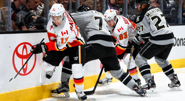 LOS ANGELES, CA - NOVEMBER 5:  Johnny Gaudreau #13 and Sam Bennett #93 of the Calgary Flames battle for the puck against Jeff Carter #77 and Alec Martinez #27 of the Los Angeles Kings on November 5, 2016 at Staples Center in Los Angeles, California. (Photo by Aaron Poole/NHLI via Getty Images)