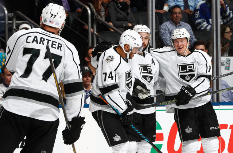 TORONTO, ON - NOVEMBER 8: Tyler Toffoli #73 (R) of the Los Angeles Kings is congratulated on his goal against the Toronto Maple Leafs by teammates Drew Doughty #8, Dwight King #74, and Jeff Carter #77 of the Los Angeles Kings during the second period at the Air Canada Centre on November 8, 2016 in Toronto, Ontario, Canada. (Photo by Mark Blinch/NHLI via Getty Images)