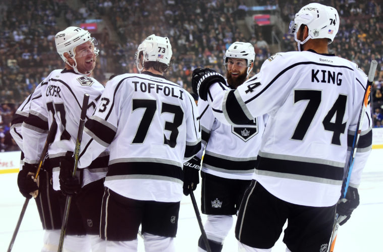 TORONTO, ON - NOVEMBER 8: Jeff Carter #77 of the Los Angeles Kings is congratulated on his goal by teammates Tyler Toffoli #73, Dwight King #74 and Jake Muzzin #6 during the second period at the Air Canada Centre on November 8, 2016 in Toronto, Ontario, Canada. (Photo by Graig Abel/NHLI via Getty Images)