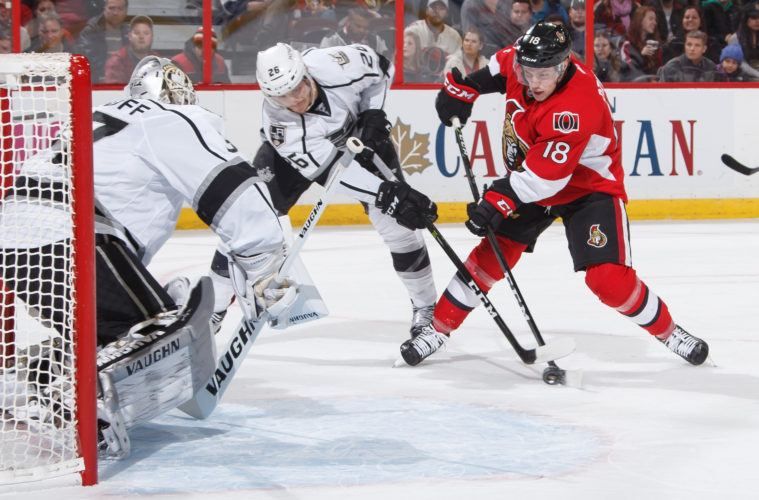 OTTAWA, ON - NOVEMBER 11: Ryan Dzingel #18 of the Ottawa Senators is stopped on a scoring chance in front of the net by Jeff Zatkoff #37 and Nic Dowd #26 of the Los Angeles Kings at Canadian Tire Centre on November 11, 2016 in Ottawa, Ontario, Canada.  (Photo by Andre Ringuette/NHLI via Getty Images)