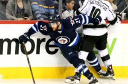WINNIPEG, MB - NOVEMBER 13: Devin Setoguchi #10 of the Los Angeles Kings checks Quinton Howden #21 of the Winnipeg Jets into the boards during second period action at the MTS Centre on November 13, 2016 in Winnipeg, Manitoba, Canada. (Photo by Darcy Finley/NHLI via Getty Images)