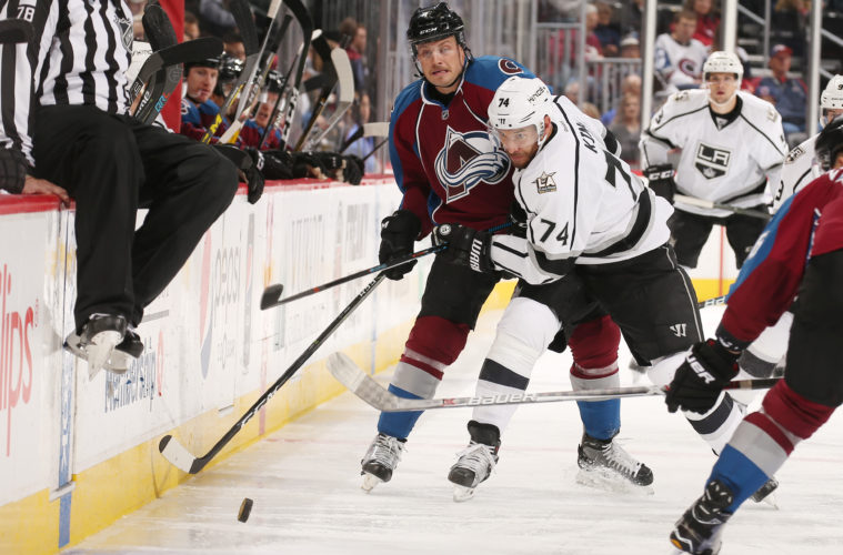 DENVER, CO - NOVEMBER 15: Dwight King #74 of the Los Angeles Kings fights for position against John Mitchell #7 of the Colorado Avalanche at the Pepsi Center on November 15, 2016 in Denver, Colorado.  (Photo by Michael Martin/NHLI via Getty Images)