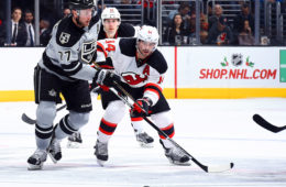 LOS ANGELES, CA - NOVEMBER 19:  Jeff Carter #77 of the Los Angeles Kings battles for the puck against Adam Henrique #14 of the New Jersey Devils on November 19, 2016 at Staples Center in Los Angeles, California. (Photo by Juan Ocampo/NHLI via Getty Images)